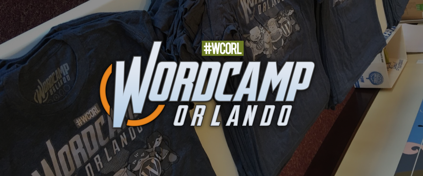 WordCamp Orlando Logo over a table of WordCamp Orlando Shirts from 2017